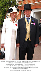 SARAH, MARCHIONESS OF MILFORD-HAVEN and MR PETER BURRELL,  at Royal Ascot on 17th June 2003.PKN 231