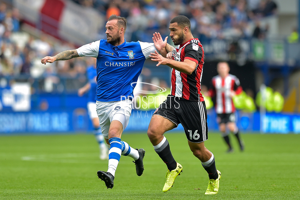 Sheffield Wednesday forward Steven Fletcher (9) and Sheffield United defender Cameron Carter-Vickers (16) during the EFL Sky Bet Championship match between Sheffield Wednesday and Sheffield Utd at Hillsborough, Sheffield, England on 24 September 2017. Photo by Adam Rivers.
