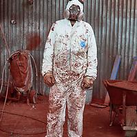 Spray painter at McKern Steel factory, Bendigo