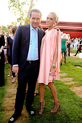 PETRA ECCLESTONE and JAMES STUNT at the annual Serpentine Gallery Summer party this year sponsored by Jaguar held at the Serpentine Gallery, Kensington Gardens, London on 8th July 2010.  2010 marks the 40th anniversary of the Serpentine Gallery and the 10th Pavilion.