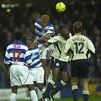 © Peter Spurrier/Sportsbeat Images <br />Tel + 441494783165 email images@sbimages.co.uk<br />29/11/2003 - Photo  Peter Spurrier<br />2003/04 Nationwide Football Div 2 QPR V Sheffield Wed<br />Clarke Carlisle out jumps to clear the ball