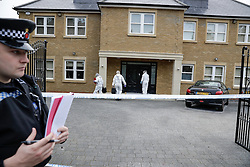 © London News Pictures. 21/05/2016. Weybridge, UK. Police forensics enter a property at St George's Hill, Weybridge, Surrey where the body of a woman in her 30's was discovered by paramedics this morning (Sat). Photo credit: Peter Macdiarmid/LNP