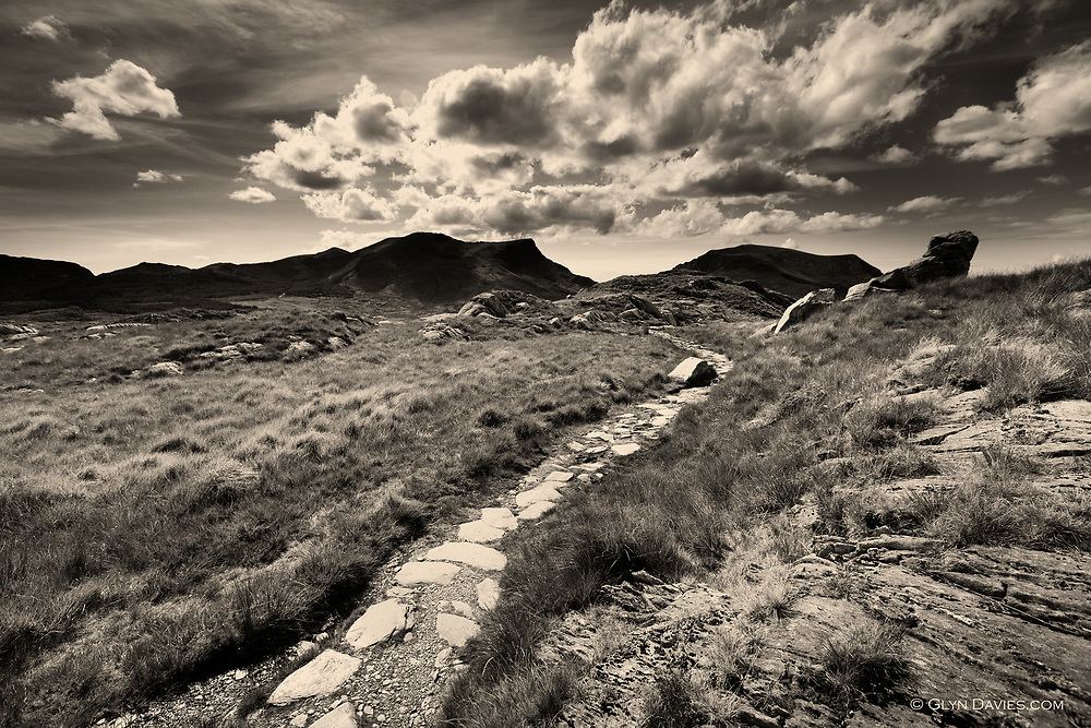 Official and hard-wearing footpaths are needed on Wales' highest mountain, Snowdon, simply due to the vast numbers of walkers aiming for it's summit. Nevertheless the hillsides and surrounding peaks are always fantastic, despite the crowds.