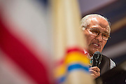 """13 JULY 2012 - FT DEFIANCE, AZ: Pastor ROGER TSOSIE, from the Window Rock Methodist Church, preaches at the 23rd annual Navajo Nation Camp Meeting in Ft. Defiance, north of Window Rock, AZ, on the Navajo reservation. Preachers from across the Navajo Nation, and the western US, come to Navajo Nation Camp Meeting to preach an evangelical form of Christianity. Evangelical Christians make up a growing part of the reservation - there are now more than a hundred camp meetings and tent revivals on the reservation every year. The camp meeting in Ft. Defiance draws nearly 200 people each night of its six day run. Many of the attendees convert to evangelical Christianity from traditional Navajo beliefs, Catholicism or Mormonism. """"Camp meetings"""" are a form of Protestant Christian religious services originating in Britain and once common in rural parts of the United States. People would travel a great distance to a particular site to camp out, listen to itinerant preachers, and pray. This suited the rural life, before cars and highways were common, because rural areas often lacked traditional churches. PHOTO BY JACK KURTZ"""