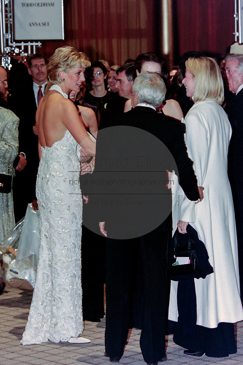 Diana, Princess of Wales is introduced to guests by fashion designer Ralph Lauren, right, during a charity gala fundraising event for the Nina Hyde Center for Breast Cancer Research September 24, 1996 in Washington, DC.