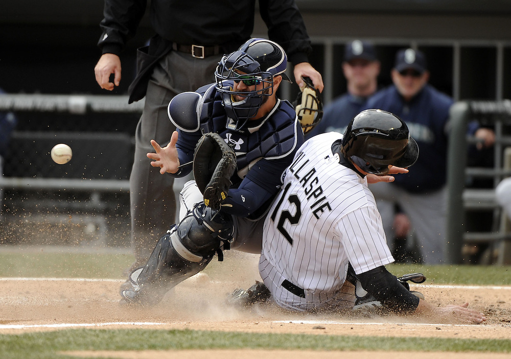 CHICAGO - APRIL 06:  Conor Gillaspie #12 of the Chicago White Sox scores on a sacrifice fly hit by Hector Gimenez #38 as Kelly Shoppach #7 of the Seattle Mariners cannot catch the ball in the fifth inning on April 06, 2013 at U.S. Cellular Field in Chicago, Illinois.  The White Sox defeated the Mariners 4-3.  (Photo by Ron Vesely)   Subject:  Conor Gillaspie; Kelly Shoppach; Hector Gimenez