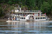 Built from 1998-2001, the Klondike Spirit paddlewheeler has offered narrated cruises on the Yukon River since 2007 from Dawson City (www.klondikespirit.com), in Yukon, Canada. Dawson City was the center of the Klondike Gold Rush (1896–99), after which population rapidly declined, in Yukon, Canada. Dawson City shrank further during World War II after the Alaska Highway bypassed it 300 miles (480 km) to the south using Whitehorse as a hub. In 1953, Whitehorse replaced Dawson City as Yukon Territory's capital. Dawson City's population dropped to 600–900 through the 1960s-1970s, but later increased as high gold prices made modern placer mining operations profitable and tourism was promoted. In Yukon, the Klondike Highway is marked as Yukon Highway 2 to Dawson City.
