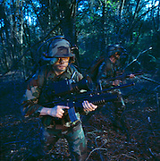 """U.S. Army soldiers at Fort Benning, Georgia test """"smart gear"""" for the new digital army.  Headsets relay real-time images back to headquarters to network the forces."""