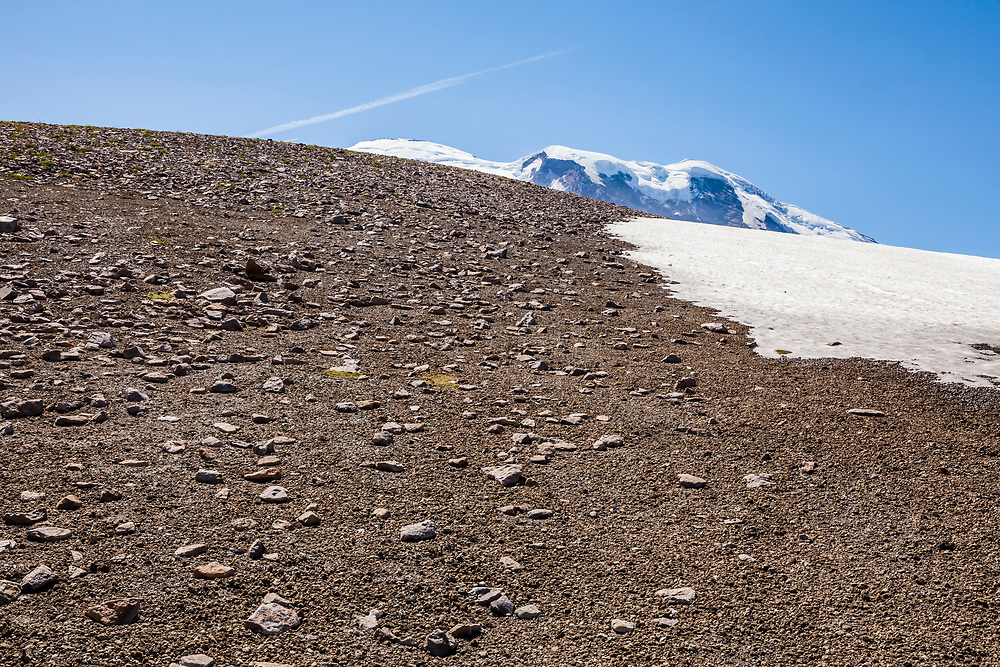 3rd Burroughs Mountain with Mount Rainier peaking over the top, Mount Rainier National Park, Washington, USA.