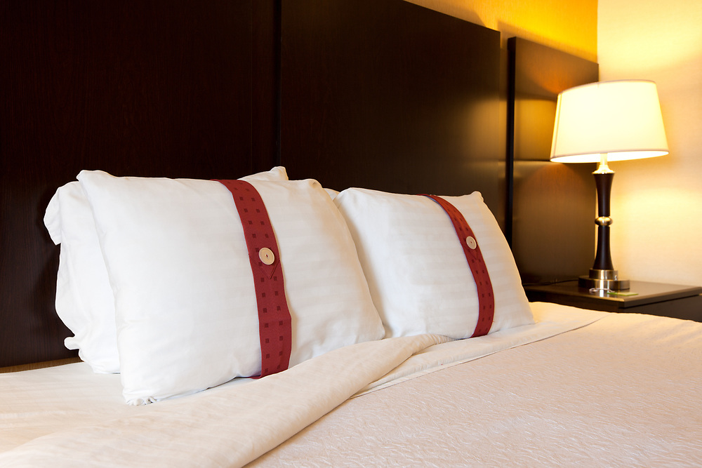 Bed and pillows at an hotel room.