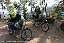 Devil Chicken artist Chris Galley at a chai stop on Motorcycle Sherpa's Ride to the Heavens motorcycle adventure in the Himalayas of Nepal. Riding from Chitwan to Daman. Tuesday, November 12, 2019. Photography ©2019 Michael Lichter.