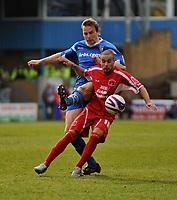 Photo: Tony Oudot/Richard Lane Photography. <br /> Gillingham Town v Carlisle United. Coca-Cola League One. 21/03/2008. <br /> Simon Hackney of Carlisle shields the ball from Simon King of Gillingham