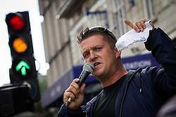 © Licensed to London News Pictures . FILE PICTURE DATED 07/09/2013 of EDL Leader STEPHEN YAXLEY-LENNON (aka Tommy Robinson ) at an EDL demonstration in London as today (8th October 2013) Yaxley-Lennon and co-leader Kevin Carroll have announced they are leaving the group . Photo credit : Joel Goodman/LNP