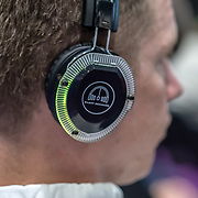 People wearing headphone listen to a speaker at London Tech Week at Excel London,on 12 June 2019, UK