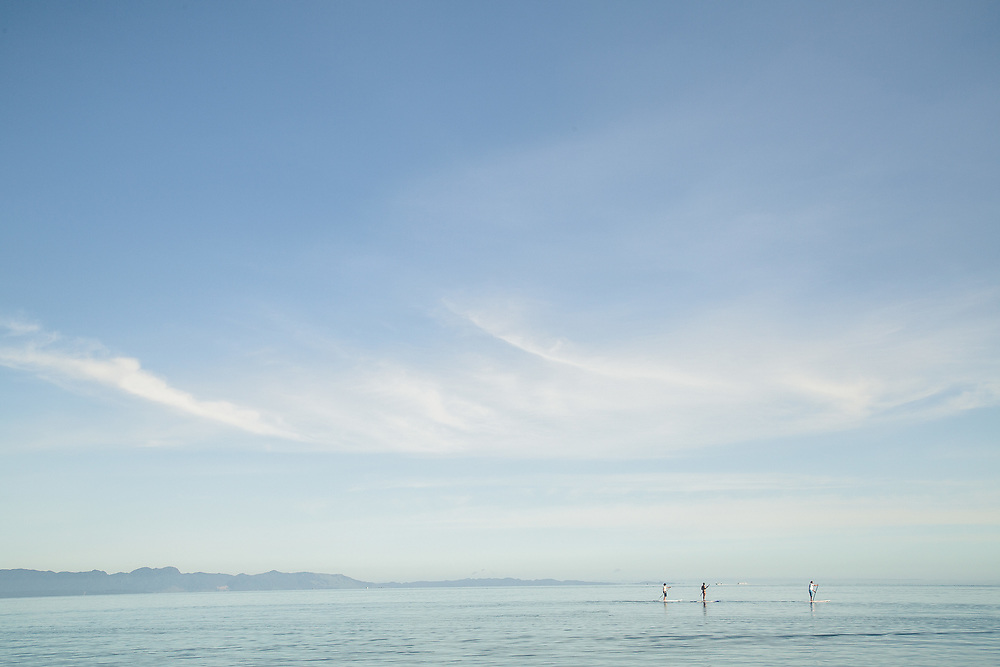 Water activities on Pohara Beach, Golden Bay,  on a calm clear day.