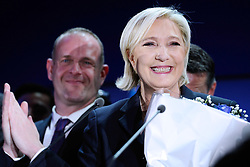 Far-right National Front leader Marine Le Pen, along with the city's mayor Steve Briois, addresses activists at the Espace Francois Mitterrand on April 23, 2017, in Henin-Beaumont, north of France. Le Pen will face centrist leader Emmanuel Macron in a run-off for the French presidency on 7 May, near-final results show. With 96% of votes counted from Sunday's first round, Mr Macron has 23.9% with Ms Le Pen on 21.4%. Photo by Aurore Marechal/ABACAPRESS.COM
