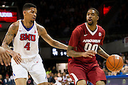 DALLAS, TX - NOVEMBER 25: Rashad Madden #00 of the Arkansas Razorbacks brings the ball up court against the SMU Mustangs on November 25, 2014 at Moody Coliseum in Dallas, Texas.  (Photo by Cooper Neill/Getty Images) *** Local Caption *** Rashad Madden