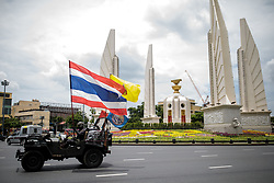 © Licensed to London News Pictures. 16/08/2020. Bangkok, Thailand. A man drives in a buggy with the Tha flag as a pro-monarchy counter-demonstration is staged ahead of a larger demonstration against the government at Democracy Monument in Bangkok, Thailand on Sunday 16th, August 2020. Photo credit: Jack Taylor/LNP