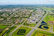 Nederland, Utrecht, Veenendaal, 29-05-2019; Rijksweg A12 met afslag naar bedrijventerrrein en zicht op Ede.<br /> Motorway A12.<br /> luchtfoto (toeslag op standard tarieven);<br /> aerial photo (additional fee required);<br /> copyright foto/photo Siebe Swart