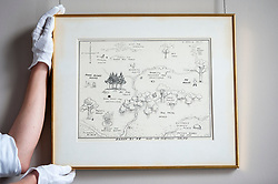 "© Licensed to London News Pictures. 31/05/2018. LONDON, UK. A gallery technician presents ""The Original Map of the Hundred Acre Wood"", 1926, by E.H. Shephard (Est. GBP100,000-150-000), which will be offered for sale at Sotheby's in New Bond Street at the English Literature, History, Science, Children's Books and Illustrations sale on 10 July. A.A. Milne's much loved characters from the Winnie-the-Pooh books inhabited the Hundred Acre Wood.  Photo credit: Stephen Chung/LNP"