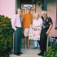 """1. When was this photo taken? <br /> <br /> July 15, 2009<br /> <br /> 2. Where was this photo taken? <br /> <br /> Front porch of 3309 Fairmount Ave. La Crescenta, CA<br /> <br /> 3. Who took this photo? <br /> <br /> Maybe our neighbor, Emil Bogenman<br /> <br /> 4. What are we looking at here? <br /> <br /> This was the day of my Dad's funeral service. We are back home. My mother, Anne Olmstead, is holding the collage I made of photos of my Dad for the service. This was a rough job; I made a more permanent display later that is still hanging on the bedroom wall. I am wearing the orange shirt, and my Dad's """"trucker mud flap"""" eye patch that he wore sometimes after losing the sight in his right eye. My younger brother Clay is wearing the tie and older brother Gary has the dark shirt.<br /> <br /> 5. How does this old photo make you feel? <br /> <br /> Nostalgia for better days. Still miss my Dad.<br /> <br /> 6. Is this what you expected to see? <br /> <br /> I had no idea what was on this roll. it was about 8 years old.<br /> <br /> 7. Does this photo bring back any memories? <br /> <br /> All the details of that day. Too many to recount here.<br /> <br /> 8. How do you think others will respond to this photo? <br /> <br /> It will probably remind them of their own parents funerals, if they have occurred. If not, I hope it spurs them to make more photos and memories while they can."""
