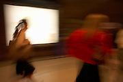 Rush hour train commuters blur through London Bridge mainline Station, walking en-route to exit and security barriers