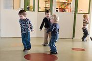 """Nederland, Herpen, 20090128...Dansen op kousenvoeten..Kinderopvang 'Op de boerderij' in Herpen...""""OP DE BOERDERIJ"""" kinderopvang..is gevestigd bij een vleesveebedrijf te Herpen.....Netherlands, Herpen, 20090128. ..Dancing on tiptoe..Childcare on the farm in Herpen. ..""""ON THE FARM"""" childcare ..is located at a beef farm in Herpen.    .."""
