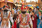 Rajasthani men in traditional dress flaunting their moustaches, symbolising the valor and glory of Rajasthan at the Desert Festival on 29th January 2018  in Jaisalmer, Rajasthan, India. It is an annual event that take place in February month in the beautiful city Jaisalmer. It is held in the Hindu month of Magh February, three days prior to the full moon.