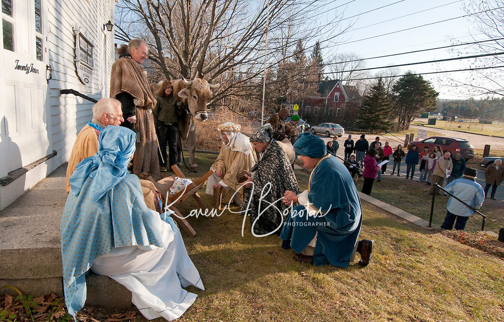 """The Gilford Community Church presented the Living Nativity scene Sunday afternoon outside the Thompson Ames Historical Society.  Mary (Kathy Lacroix), Joseph (Jim Colby), Innkeeper (Peter Ayer), Kathy Salanitro with """"Chip"""" and the Three Wise Men (George Hetherington, Carl Gebhardt and Leon Albushies).  (Karen Bobotas/for the Laconia Daily Sun)"""