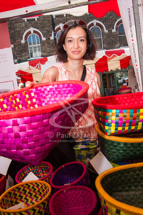 Primrose Hill, London, May 18th 2014. Poornima Nair sells baskets made by a women's charity in India, woven from palm leaves and recycled newspapers.