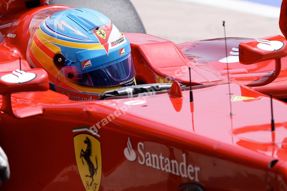 Fernando Alonso (Ferrari) with helmet on before the 2012 European Grand Prix in Valencia. Photo: Grand Prix Photo