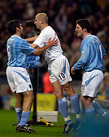 Photo. Jed Wee.<br />Manchester City v Leeds United, FA Barclaycard Premiership, City of Manchester Stadium, Manchester. 22/12/2003.<br />Manchester City's Antoine Sibierski I(C) celebrates his goal with Claudio Reyna (L) and Jon Macken.