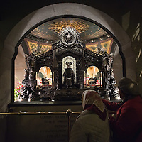 MILAN, ITALY - DECEMBER 07:  Pilgrims, pray in front of the relics of Saint Ambrogio on December 7, 2010 in Milan, Italy. The skeleton of Saint Ambrogio lays with the remains of San Gervasio e San Protasio in the ancient basilica of Sant'Ambrogio in the city centre of Milan