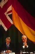 With the British and German flags behind, British Prime Minister, John Major and Chancellor Helmut Kohl during the joint press conference during the Anglo-German summit on 11th November 1992 at Heythrop Park in Oxfordshire, England.