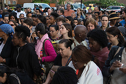 London, June 15th 2017. Local residents and well-wishers gather at a short vigil outside Notting Hill Methodist Church near the scene of the Grenfell Tower Fire Disaster in which so far seventeen people have been reported killed, with dozens injured, many still missing and scores of people rendered homeless. PICTURED: The crowd listens to the words of one of the church's leaders.