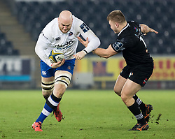 Bath Rugby's Matt Garvey under pressure from Ospreys' Ifan Phillips<br /> <br /> Photographer Simon King/Replay Images<br /> <br /> Anglo-Welsh Cup Round 4 - Ospreys v Bath Rugby - Friday 2nd February 2018 - Liberty Stadium - Swansea<br /> <br /> World Copyright © Replay Images . All rights reserved. info@replayimages.co.uk - http://replayimages.co.uk