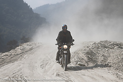 Round the World Doug Wothke in a particularly dusty part of the route on Day-7 of our Himalayan Heroes adventure riding from Tatopani to Pokhara, Nepal. Monday, November 12, 2018. Photography ©2018 Michael Lichter.