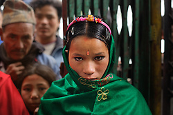 A nine-months pregnant Niruta, 14, arrives at her wedding ceremony in Kagati village Nepal on Jan. 23, 2007, which was the auspicious day of Vasant Panchami, a Hindu holiday celebrating the coming of spring.  Niruta moved in with the family of Durga, 16, the year before and was pregnant three months later. <br /> <br /> The 2015 earthquakes devastated Nepal and left girls and women in an increasingly vulnerable position, leading experts to believe child marriage rates will increase over the coming years.