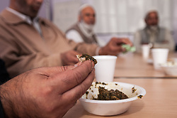 Community elders at a public meeting / lunch club in Rotherham