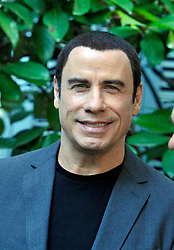 John Travolta attending the Italian premiere of Savages in Rome.