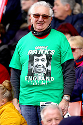A fan in the stands wears a Gordon Banks t-shirt ahead of the funeral cortege for Gordon Banks at bet365 Stadium, Stoke.