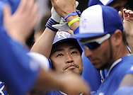 SURPRISE, AZ - MARCH 06:  Norichika Aoki #23 of the Kansas City Royals celebrates with teammates after scoring a run against the Chicago White Sox on March 6, 2014 at The Ballpark in Surprise in Surprise, Arizona. (Photo by Ron Vesely)   Subject: Norichika Aoki