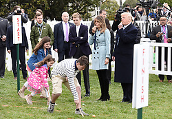 President Donald Trump, with First Lady Melania Trump, and son Barron Trump, blows a whistle to begin an Easter Egg Roll race during the 140th Easter Egg Roll on the South Lawn of the White House in Washington, DC on Monday, April 2, 2018. Photo by Olivier Douliery/Abaca Press