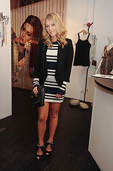 CHLOE MADELEY at a party to celebrate the opening of the new Mina Store at 36-38 Great Titchfield Street, London W1W 8BQ on 9th September 2010.  The party was sponsored by Ivan the Terrible Vodka.