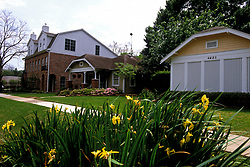 Stock photo of houses with flowers in the front yard