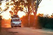 Van driving down a dusty road towards Morondava, Madagascar