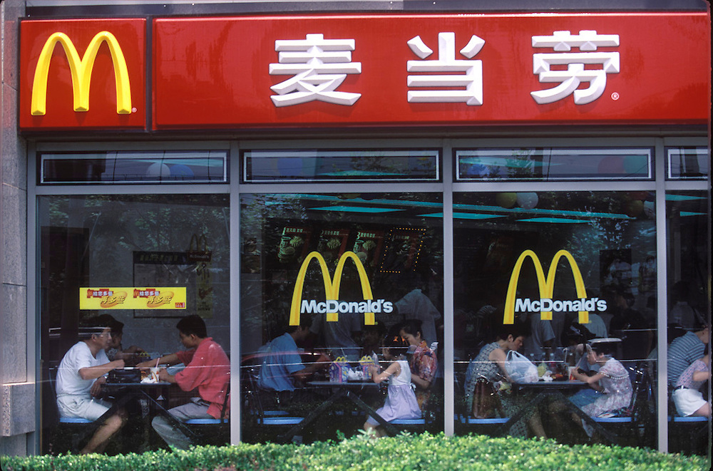 Chinese McDonald's in Shanghai's Pudong new area. (Supporting image from the project Hungry Planet: What the World Eats) Fast Food. Has any human invention ever been as loved and loathed as fast food? Feelings run deep about the huge U.S. fast-food chains, especially McDonald's and KFC. Internationally recognized as symbols of Americanization, globalization, and overflowing schedules, they are also symbols of convenience, reliability, and (usually) cleanliness.