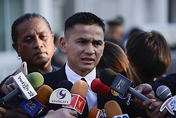 November 3, 2018 - Bangkok, Thailand - Former Thailand's coach Kiatisuk Senamuang speaks to the media as he arrives at the Wat Thepsirin Buddhist temple in funeral ceremony of Vichai Srivaddhanaprabha, late chairman of Leicester City Football Club, in Bangkok, Thailand November 3, 2018. (Credit Image: © Anusak Laowilas/NurPhoto via ZUMA Press)
