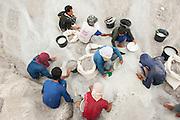 Miners sift sand in seach of tin in an illegal tin mine in Reboh, Bangka Island, Indonesia. The island is devastated by this deadly tin rush, a direct consequence of the success of smartphones and tablets like iPhones and iPads from Apple or Samsung. The demand for tin has increased due to its use in smart phones and tablets.<br /> <br /> Mineurs tamisent du sable dans une Mine d'étain illégale à Reboh, île de Bangka (Indonésie). L'île est dévastée par cette ruée d'étain mortelle, une conséquence directe du succès des smartphones et tablettes comme les iPhones et les iPads d'Apple ou Samsung. La demande de l'étain a explosé à cause de son utilisation dans les smartphones et tablettes.