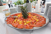 party outdoors, tasty appetizer, plate of salmon with ananas